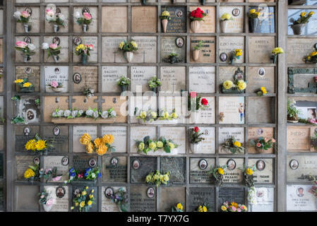 Monumental Cemetery, Milan, Italy, featuring a Columbarium wall for cinerary urns. - Stock Image