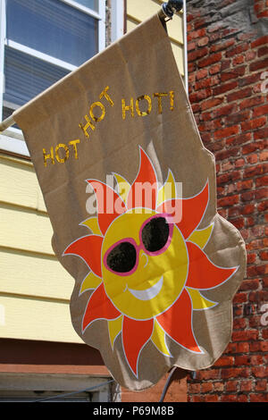 NEW YORK, NY - JUNE 26: HOT HOT HOT! Sunny banner hanged on display outside a house on a sunny summer day in Sunset Park, Brooklyn on JUNE 26th, 2017  - Stock Image