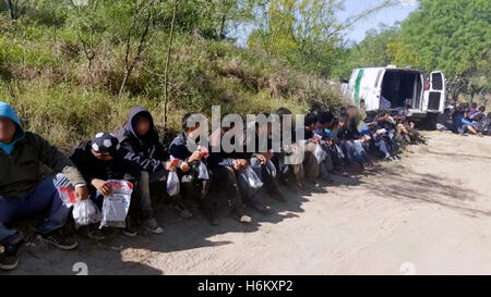 102 illegal immigrants apprehended by boarder patrol agents along the US Mexico border on 7 April 2016 near Fronton, - Stock Image
