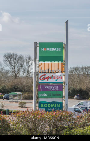 Corporate logos (including failing Carpetright & Homebase) at Bodmin Retail Park, Cornwall. Sign of high street recession and shop / store failures. - Stock Image