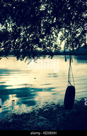 tyre swing, evening on the Lake of Mentieth, Scotland.f - Stock Image