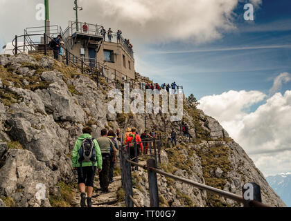 Bayrischzell, Bavaria, Germany - June 1, 2019.  Tourists crowd the peak of Mount Wendelstein on a very nice spring day - Stock Image