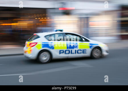 A moving police car - Stock Image