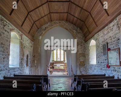 Interior of St Botolph's Church Iken Suffolk, looking down aisle towards the altar - Stock Image