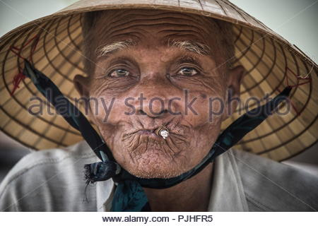 Vietnam, Hoi An, portrait of an old man with his cigarete - Stock Image