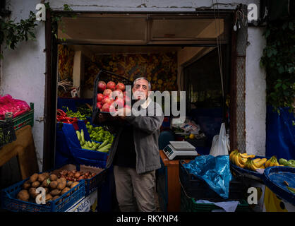 Grocer selling fruit and vegetables in Istanbul in Turkey. - Stock Image