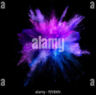 Explosion of coloured powder isolated on black background. Abstract colored background - Stock Image
