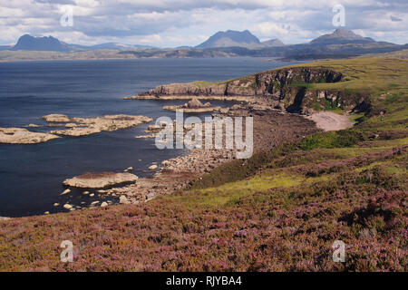 A view from the Coigach Peninsula over Enard Bay to Inverpolly Forest, Scotland on a sunny summer's day with mountains, sea and skyscape - Stock Image