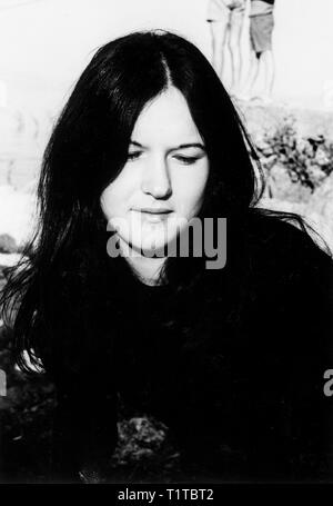 1970s Outdoor portrait of a young woman in black and white taken with 35mm film - Stock Image