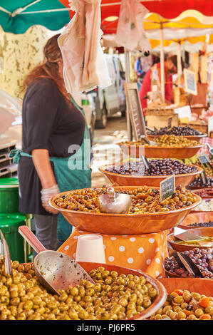 Market stall selling olives in the Ardeche town of Lamstre - Stock Image