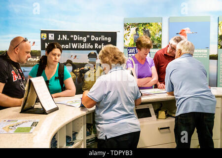 Sanibel Island Florida J.N. Ding Darling National Wildlife Refuge environmental conservation education visitors center information counter man woman v - Stock Image