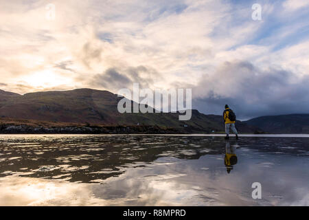 Ardara, County Donegal, Ireland. 16th December 2018. A walker takes to the beach on a cold, windy afternoon after storms have passed. Credit: Richard Wayman/Alamy Live News - Stock Image