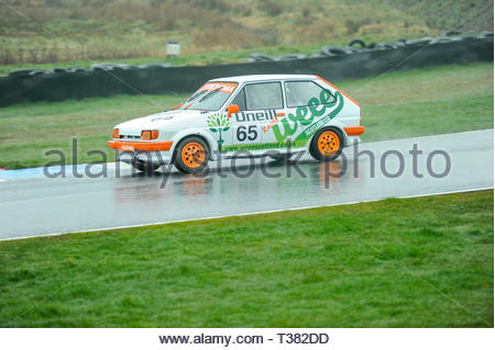 Dunfermline, UK. 7th April, 2019.   65 Gary Taylor during qualifying for a Scottish Classic Sports and Saloons Championship race at Knockhill Circuit. During a wet and misty start to the Scottish Championship Car Racing season organised by the SMRC (Scottish Motor Racing Club) at Knockhill. Credit: Roger Gaisford/Alamy Live News - Stock Image