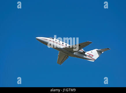 French registered Raytheon Hawker 400XP departing form Inverness Dalcross Airport in Highland Region. Scotland.UK. - Stock Image