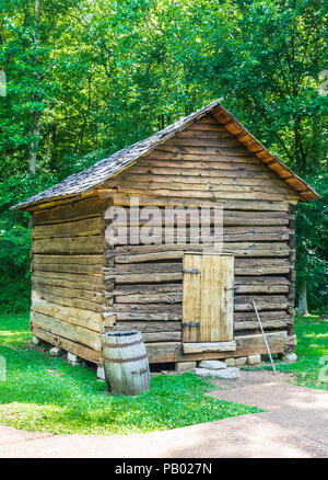GOLDEN POND, KY, USA-30 JUNE 18: An outbuilding on The Homeplace, an 1850s working farm and living history museum, located on The Trace. - Stock Image