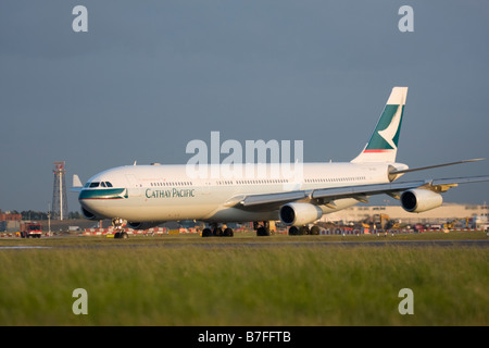 Cathay Pacific Airways Airbus A340-313X at London Heathrow airport. - Stock Image