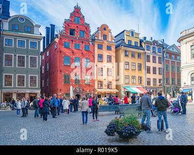 18 September 2018: Stockholm, Sweden - Tourists enjoying the ambience whilst sightseeing in Stortorget, the oldest square in the old town, Gamla Stan. - Stock Image
