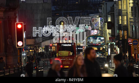 Brighton UK 26th November 2018 - Shoppers and traffic  out in force in  the North Street area of Brighton late this afternoon as Christmas shopping gets in full swing amongst the lights Credit: Simon Dack/Alamy Live News - Stock Image