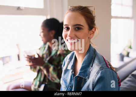 Portrait smiling, confident young woman - Stock Image