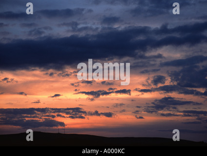 Hill and burning sunset - Stock Image