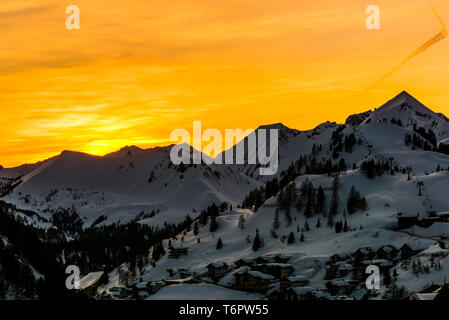 Orange skies just after sunset at Obertauern, Austria - Stock Image