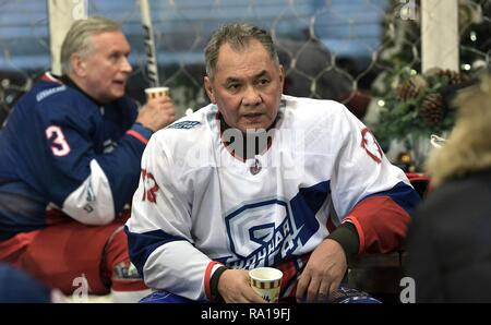 Moscow, Russia. 29th December 2018. Russian Defense Minister Sergei Shoigu following the Night Hockey League match in the rink at the GUM Department store in Red Square December 29, 2018 in Moscow, Russia. Credit: Planetpix/Alamy Live News - Stock Image