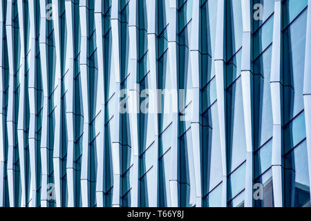 Architectural abstract, a modern office building with glass and windows in London - Stock Image