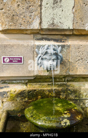 A classic ornamental drinking fountain in the walled garden at Castle Howard with a 'Not Drinking Water' sign - Stock Image