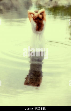 young woman,lake,dreams,bathing,suicide - Stock Image