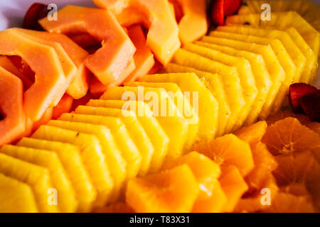 Close up of fresh coloured exotic tropiacl fruits like pine and melon - seasonal natural food for healthy lifestyle and vegetarian people - Stock Image