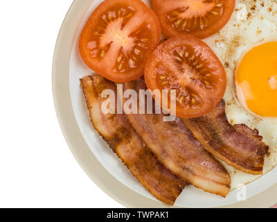 Bacon Egg and Tomato Breakfast Food Against a Pink Background - Stock Image