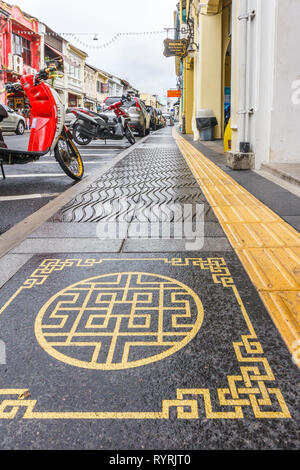 Phuket, Thailand - 11th April 2017: New pavements with ornate Chinese design. Many parts of the old town are being rejuvenated. - Stock Image