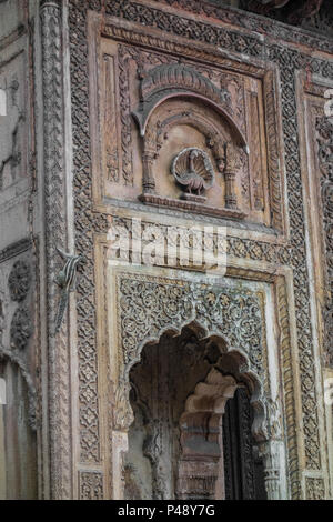 Detail of an exhibit of a gateway to a haveli or mansion typical of Rajasthan with a chipmunk at corner, National Crafts Museum, New Delhi, India - Stock Image