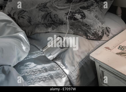 tin can telephone on bed - Stock Image