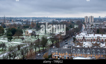London, England, UK - December 5, 2012: Winter frost and snow lies in the Lambeth Cemetery on Blackshaw Road in Tooting. - Stock Image