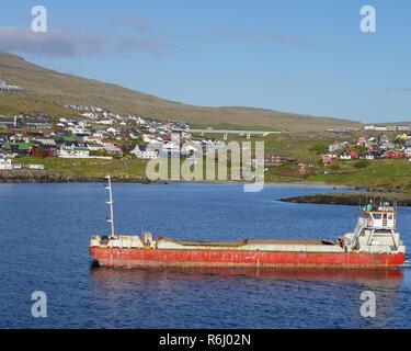 Large shop leaving Torshavn Harbour, the capital of the Faroe Islands - Stock Image