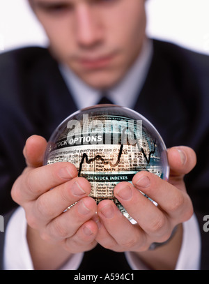 BUSINESSMAN WITH CRYSTAL BALL STOCK MARKET WALLSTREET - Stock Image
