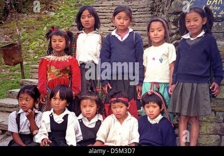 Group of Primary School children girls and boys near Chomrong on Annapurna circuit Nepal Himalaya - Stock Image