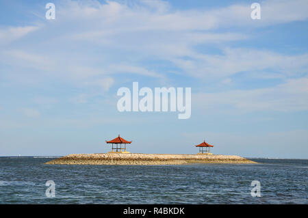 Secluded Balinese pagodas in the popular resort of Sanur Bali, Indonesia. - Stock Image