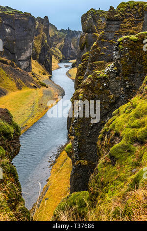 Fjaðrárgljúfur is a magnificent and massive canyon, about 100 meters deep and about two kilometres long. The canyon has sheer walls, and is somewhat s - Stock Image