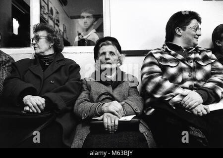 Audience sat at back of hall watching performance at small eisteddfod in village hall Talsarnau Gwynedd Wales UK - Stock Image