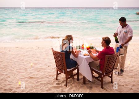 Private dining on the beach at Kuramathi Island Resort, Maldives. - Stock Image