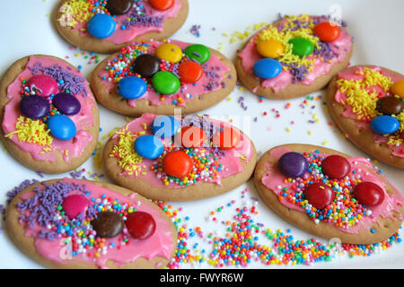 Cookies or biscuits, decorated with sprinkles and candy. - Stock Image