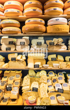 display of cheese on sale at Zuivelhoeve cheese shop, Leeuwarden, Netherlands - Stock Image