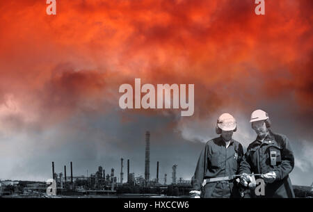 refinery workers and oil and gas industry with a toxic and red sky - Stock Image