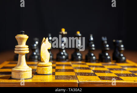 white chess queen and horse standing on the chessboard closeup - Stock Image