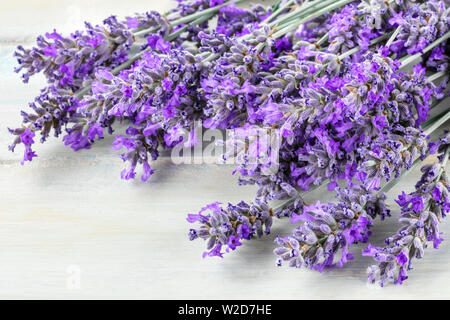 A bouquet of blooming lavender flowers on a wooden background - Stock Image
