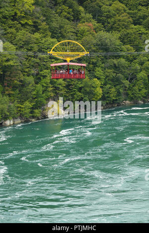 Niagara Falls, USA – August 29, 2018: Aero Cable car suspended on a sturdy cable with the view of the Niagara Whirlpool wild rivers from New York Stat - Stock Image