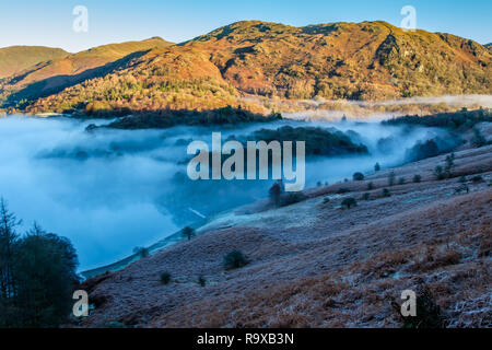 Mist stretch through from the lake at Grasmere towards Rydal Water, Grasmere, Lake District, Cumbria - Stock Image