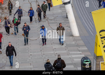 Pedestrians seen from a high vantage point walk along the South Bank past the South Bank Centre in London - Stock Image